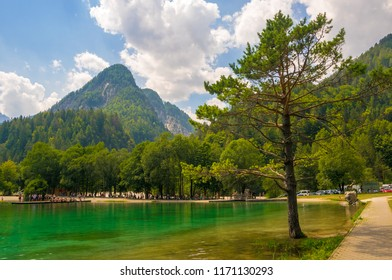 Scenic view of emerald water of Jasna lake near Kranjska Gora in Slovenia. Julian Alps in background