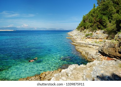 Scenic view of Emplisi Beach, picturesque stony beach in a secluded bay, with clear waters popular for snorkelling. Small pebble beach near Fiscardo town of Kefalonia, Ionian islands, Greece.