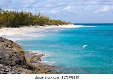 The scenic view of an empty beach of uninhabited island Half Moon Cay (Bahamas).