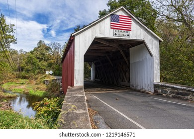 A scenic view of the Erwinna Covered Bridgethat spans Swamp Creek in Bucks County Pennsylvania.