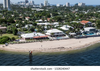 A scenic view of expensive homes on the beach in Fort Lauderdale Florida.