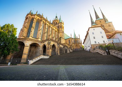 Scenic view of famous Erfurt Cathedral Hohe Domkirche St. Marien and famous St Severus's Church in the old city center of Erfurt in beautiful evening light at sunset in summer, Thuringia, Germany