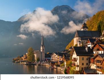 Scenic view of famous Hallstatt mountain village in the Alps under picturesque clouds at autumn morning. UNESCO World Heritage, Hallstatt-Dachstein, Salzkammergut, Upper Austria