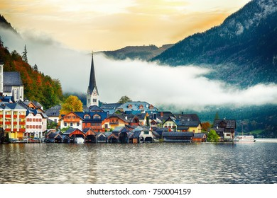 Scenic view of famous Hallstatt mountain village with Hallstatter lake. Foggy autumn sunrise on Hallstatt lake. Location: resort village Hallstatt, Salzkammergut region, Austria, Alps. Europe.