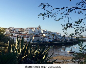 Scenic view of Ferragudo, a typical portuguese fishing village with whitewashed houses at the Arade River (Western Algarve, Portugal)