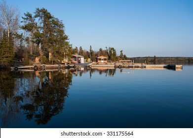 Scenic view of fishermen houses along shore of a lake in Kenora, Ontario