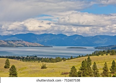 A scenic view of Flathead Lake from Polson,MT.with clouds over the mountains in the background