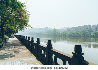 scenic view of footpath along the river in a park,shot in Shanghai,China.