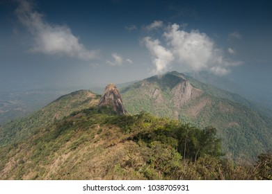 Scenic view of forest, mountains and clouds