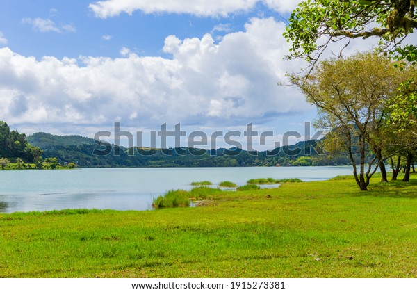 Scenic view of Furnas lake in Sao Miguel island, Azores, Portugal. An enchanting and tranquil scene of lush foliage and the lake in a volcanic crater