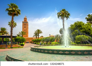 Scenic view from garden with fountain of minaret of Koutoubia Mosque in Marrakech. Morocco, North Africa