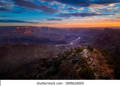 Scenic view of the Grand Canyon and the Colorado River from the Desert View viewpoint, in the Grand Canyon National Park, at sunrise, in the State of Arizona, USA