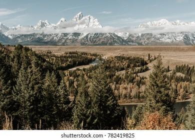 Scenic view of Grand Teton Mountain Range from Snake River vantage point, inspired by famous Ansel Adams location.