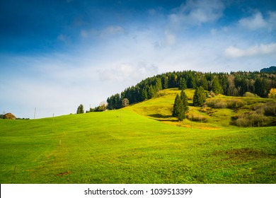 Scenic view of grass field against sky in Switzerland