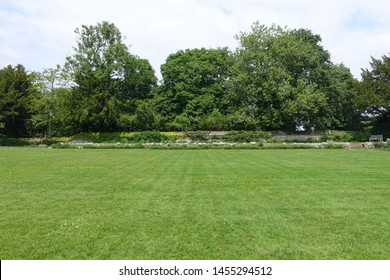 Scenic View of a Green Mowed Lawn in a Beautiful English Style Landscape Garden