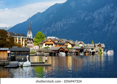 Scenic view of Hallstatt lakeside town in the Austrian Alps in beautiful evening light on beautiful day in autumn. Hallstatt, situated on Hallstatter See, a market town in the district of Gmunden.
