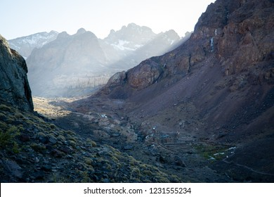 Scenic view of the highest refuge from the trail coming back from the summit of Mount Toubkal, Atlas, Morocco, Atlas. The sun shines through the mist coming from the mountain