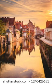 Scenic view of the historic city center of Brugge in beautiful golden morning light at sunrise, province of West Flanders, Belgium