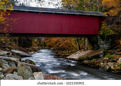 A scenic view of the historic McConnell`s Mill covered Howe truss bridge along Slippery Rock Creek during an autumn afternoon at McConnell`s Mill State Park in western Pennsylvania.