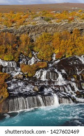 A scenic view of the Hraunfossar waterfalls, located near Husafell and Reykholt in West Iceland. Hraunfossar is a series of waterfalls runs out of the Hallmundarhrau lava field into the Hvita river.