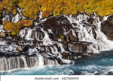 A scenic view of the Hraunfossar waterfalls, located near Husafell and Reykholt in West Iceland. Hraunfossar waterfalls - one of the most beautiful waterfalls in Iceland.