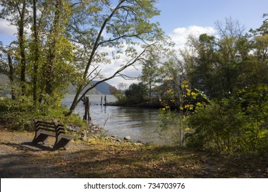 A scenic view of the Hudson River and surrounding mountains seen from Plum Point Park in New Windsor, New York.