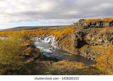 Scenic view of Hvita River and Hraunfossar waterfalls. Hraunfossar is a series of waterfalls runs out of the Hallmundarhrau lava field into the Hvita river in West Iceland