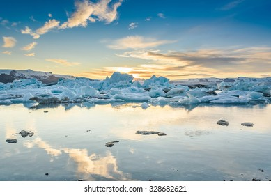 Scenic view of icebergs in Jokulsarlon glacier lagoon, Iceland, at sunset, selective focus,  global warming and climate change concept