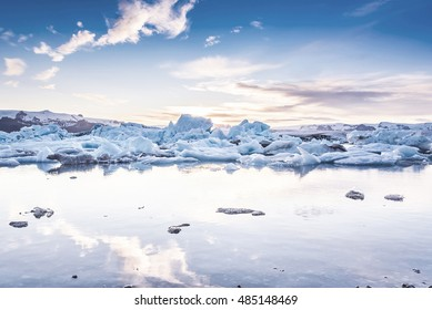 Scenic view of icebergs in Jokulsarlon glacier lagoon, Iceland, at sunset, selective focus, cool vintage style effect