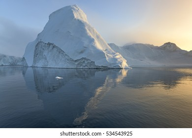 Scenic view of the icebergs with summer midnight sunlight in ilulissat, Greenland
