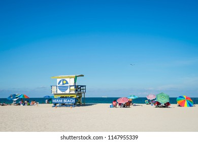 Scenic view of an iconic yellow and blue lifeguard tower on South Beach, Miami