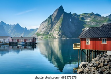 Scenic view from idyllic village with mountains at bright summer day in Hamnoy, Lofoten, Norway