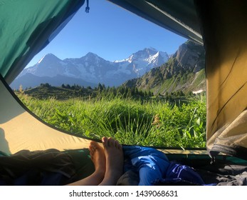 scenic view from inside a tent on to swiss alps eiger mönch and jungfraujoch