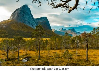 Scenic view into the Efjorddalen valley with Eidtinden, Stortinden and Leirpollvatnet lake in Norway in autumn