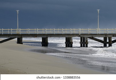 Scenic view of a jetty in the Versilia coastline on a stormy winter day