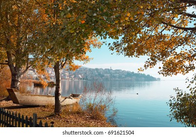 Scenic view of Kastoria and lake Orestiada through aspens branches in autumn