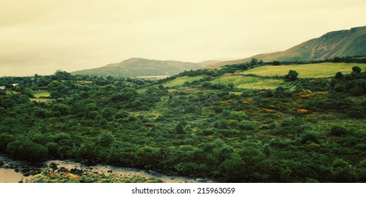 A scenic view of a Kerry Mountains and surrounding areas in County Kerry - vintage effect. Landscape along the Ring of Kerry - retro photo. Ireland. Wide photo for web page slider.