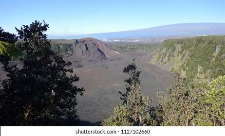 Scenic view of Kilauea Iki crater (in front), steaming Kilauea crater (in the middle), and Mauna Loa mountain (on the back) in Volcanoes National Park (Big Island, HI, USA)