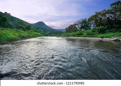 Scenic view of Kiriwong river with beautiful sunset in Kiriwong village, Lan Saka district of Nakorn sri thammarat, Thailand.