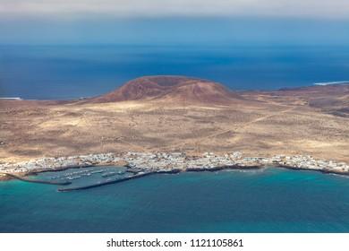 Scenic view of La Graciosa Island from Mirador del Rio, Lanzarote, Canary Islands, Spain. travel destination concept. Bird eye view