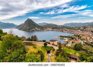 Scenic view of lake Lugano with Monte San Salvatore and Lugano town, Ticino, Switzerland