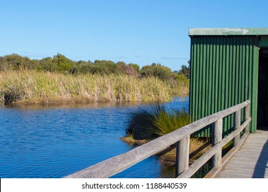 Scenic  view of the lake and parklands from  the green painted bird hide at  Big Swamp parkland Bunbury Western Australia on a fine sunny winter  afternoon.