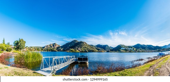 A scenic view in Lake Sherwood in the Santa Monica Mountains, in Ventura County, California overlooking the Lake Sherwood reservoir. It is south of the Conejo Valley and city of Thousand Oaks,