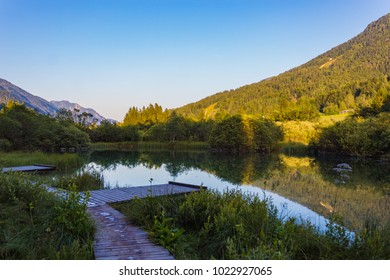 Scenic view of lake surrounded by nature and mountain on background. Zelenci natural reserve, Kranjsca Gora, Slovenia
