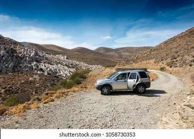 Scenic view of landscape with car on mountain road, Crete, Greece