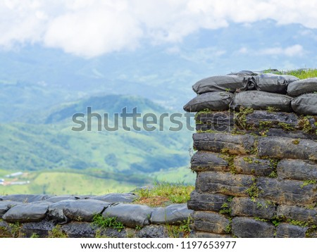 Scenic view landscape of mountains and sandbag bunkers in chiangrai  province border of Thailand and Myanmar - Scenic View Landscape Mountains Sandbag Bunkers Stock Photo (Edit