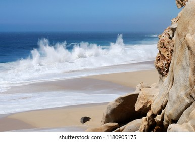 The scenic view of Lovers' beach with big waves in Cabo San Lucas resort town (Mexico).