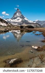 Scenic view of Matterhorn and its reflection on Riffelsee, an alpine lake of Riffelhorn in Zermatt, Switzerland.