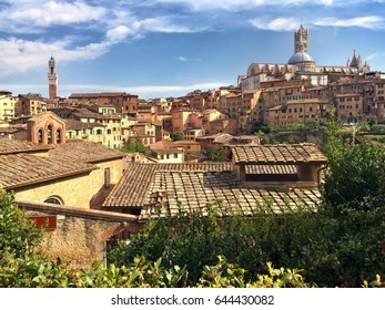 Scenic view of medieval center of Siena  with Torres del Mangia and Duomo on sunny spring day. Tuscany, Italy.