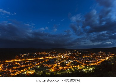Scenic view of medieval Sighisoara town at twilight with clouds. Iis one of the few fortified towns which are still inhabited